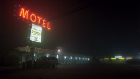 682433919-motel-blinking-light-neon-light-illuminated-advertising